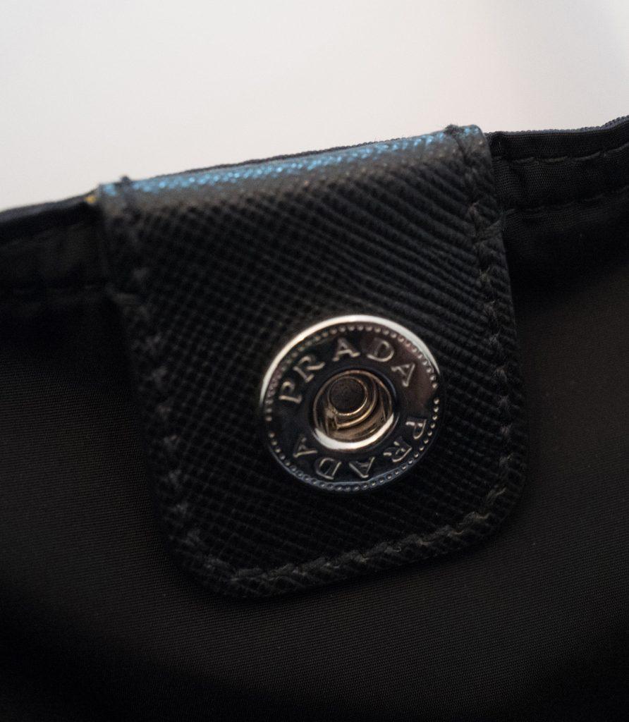 Prada logo button inside tote bag
